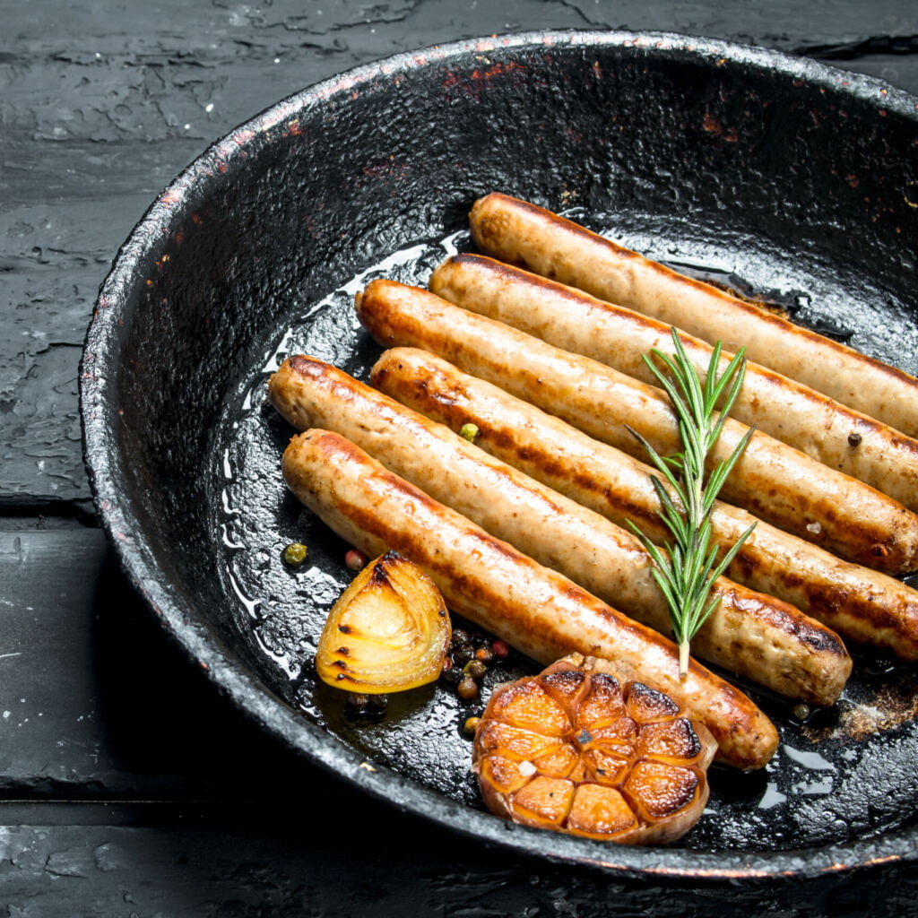 frying Traditional Pork sausages